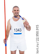 Athlete with olympic gold medal holding javelin. Стоковое фото, агентство Wavebreak Media / Фотобанк Лори