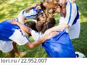 Купить «Overhead view of soccer team forming huddle», фото № 22952007, снято 3 марта 2016 г. (c) Wavebreak Media / Фотобанк Лори