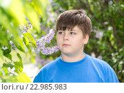 Купить «boy smelling a lilac flowers in park», фото № 22985983, снято 15 мая 2016 г. (c) Володина Ольга / Фотобанк Лори