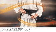 Купить «Composite image of mid section of fighter tightening karate belt», фото № 22991507, снято 18 августа 2019 г. (c) Wavebreak Media / Фотобанк Лори