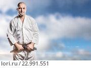 Купить «Composite image of fighter tightening karate belt», фото № 22991551, снято 18 августа 2019 г. (c) Wavebreak Media / Фотобанк Лори