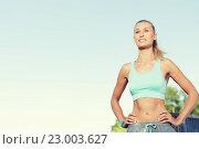 Купить «happy young woman exercising outside», фото № 23003627, снято 5 июля 2015 г. (c) Syda Productions / Фотобанк Лори
