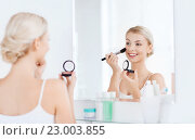 Купить «woman with makeup brush and blush at bathroom», фото № 23003855, снято 13 февраля 2016 г. (c) Syda Productions / Фотобанк Лори