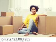 Купить «happy african woman with cardboard boxes at home», фото № 23003935, снято 4 июня 2015 г. (c) Syda Productions / Фотобанк Лори