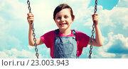 Купить «happy little girl swinging on swing over blue sky», фото № 23003943, снято 13 июня 2015 г. (c) Syda Productions / Фотобанк Лори