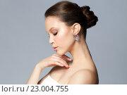 Купить «close up of beautiful woman face with earring», фото № 23004755, снято 9 апреля 2016 г. (c) Syda Productions / Фотобанк Лори