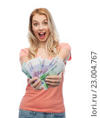 Купить «happy young woman with euro cash money», фото № 23004767, снято 30 апреля 2016 г. (c) Syda Productions / Фотобанк Лори