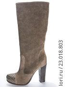 Купить «Женский коричневый сапог на высоком каблуке с украшением на носке», фото № 23018803, снято 18 августа 2010 г. (c) Olesya Tseytlin / Фотобанк Лори