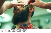 Купить «Hipster in the barber shop», видеоролик № 23028691, снято 1 июня 2016 г. (c) Raev Denis / Фотобанк Лори