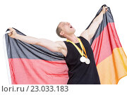 Athlete posing with olympic gold medals around his neck. Стоковое фото, агентство Wavebreak Media / Фотобанк Лори