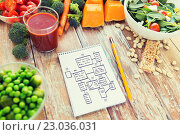 close up of ripe vegetables and notebook on table. Стоковое фото, фотограф Syda Productions / Фотобанк Лори