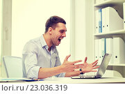 Купить «angry businessman with laptop and papers in office», фото № 23036319, снято 18 июня 2015 г. (c) Syda Productions / Фотобанк Лори