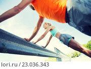 Купить «close up of happy couple doing push-ups outdoors», фото № 23036343, снято 5 июля 2015 г. (c) Syda Productions / Фотобанк Лори
