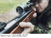 Купить «close up of soldier or sniper with gun in forest», фото № 23036527, снято 14 августа 2014 г. (c) Syda Productions / Фотобанк Лори