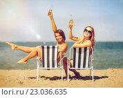 Купить «girls sunbathing on the beach chairs», фото № 23036635, снято 11 июля 2013 г. (c) Syda Productions / Фотобанк Лори