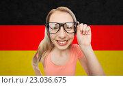 Купить «happy young woman or teenage girl in eyeglasses», фото № 23036675, снято 30 апреля 2016 г. (c) Syda Productions / Фотобанк Лори