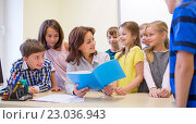 Купить «group of school kids with teacher in classroom», фото № 23036943, снято 15 ноября 2014 г. (c) Syda Productions / Фотобанк Лори