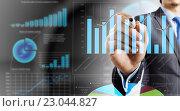 Купить «Analyzing sales data», фото № 23044827, снято 24 февраля 2011 г. (c) Sergey Nivens / Фотобанк Лори