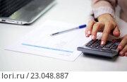 Купить «businesswoman with laptop, calculator and papers», видеоролик № 23048887, снято 18 марта 2016 г. (c) Syda Productions / Фотобанк Лори