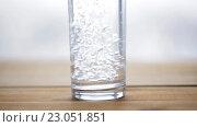 Купить «water pouring into glass on wooden table», видеоролик № 23051851, снято 2 апреля 2016 г. (c) Syda Productions / Фотобанк Лори