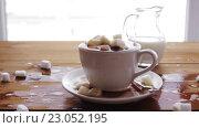 Купить «coffee cup full of lump sugar on wooden table», видеоролик № 23052195, снято 15 апреля 2016 г. (c) Syda Productions / Фотобанк Лори
