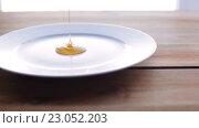 Купить «liquid honey pouring to plate on wooden table», видеоролик № 23052203, снято 15 апреля 2016 г. (c) Syda Productions / Фотобанк Лори