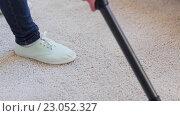 Купить «woman with vacuum cleaner cleaning carpet at home», видеоролик № 23052327, снято 17 апреля 2016 г. (c) Syda Productions / Фотобанк Лори
