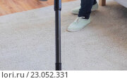 Купить «woman with vacuum cleaner cleaning carpet at home», видеоролик № 23052331, снято 17 апреля 2016 г. (c) Syda Productions / Фотобанк Лори