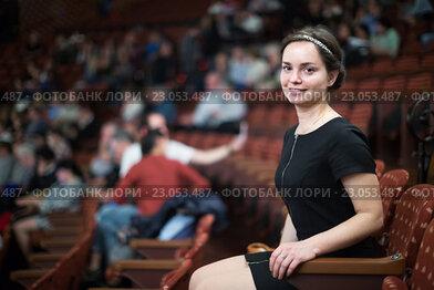 Купить «Brunette girl sitting in theatre», фото № 23053487, снято 2 июля 2020 г. (c) Яков Филимонов / Фотобанк Лори