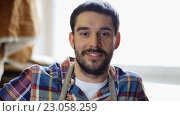 Купить «workman in checkered shirt and apron at workshop», видеоролик № 23058259, снято 21 мая 2016 г. (c) Syda Productions / Фотобанк Лори