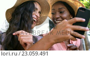 Купить «Young hipsters are looking a smartphone and laughing », видеоролик № 23059491, снято 19 августа 2019 г. (c) Wavebreak Media / Фотобанк Лори