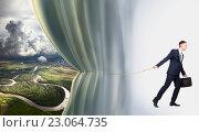 Купить «Young businessman shows weather forecast, conceptual idea», фото № 23064735, снято 11 мая 2016 г. (c) Владимир Мельников / Фотобанк Лори