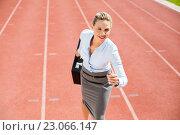 Купить «Businesswoman in ready to run position», фото № 23066147, снято 14 января 2016 г. (c) Wavebreak Media / Фотобанк Лори