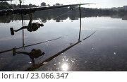 Купить «Удочки. Рыбалка на рассвете», видеоролик № 23066347, снято 10 июня 2016 г. (c) Денис Зарубин / Фотобанк Лори