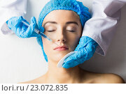 Купить «Woman receiving botox injection on her lips», фото № 23072835, снято 3 февраля 2016 г. (c) Wavebreak Media / Фотобанк Лори