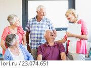Купить «Seniors and nurse laughing together», фото № 23074651, снято 2 марта 2016 г. (c) Wavebreak Media / Фотобанк Лори