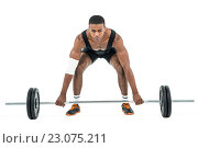Купить «Bodybuilder lifting heavy barbell weights», фото № 23075211, снято 14 октября 2015 г. (c) Wavebreak Media / Фотобанк Лори