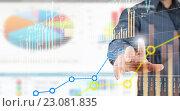 Купить «Analyzing sales data», фото № 23081835, снято 24 февраля 2011 г. (c) Sergey Nivens / Фотобанк Лори
