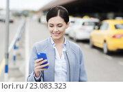 Купить «smiling woman with smartphone over taxi in city», фото № 23083323, снято 10 мая 2015 г. (c) Syda Productions / Фотобанк Лори