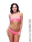 Купить «happy young woman in pink bikini swimsuit», фото № 23083723, снято 14 апреля 2015 г. (c) Syda Productions / Фотобанк Лори