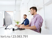 Купить «man or designer with computer and tablet at office», фото № 23083791, снято 27 февраля 2016 г. (c) Syda Productions / Фотобанк Лори