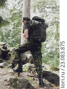 Купить «young soldier with backpack in forest», фото № 23083875, снято 14 августа 2014 г. (c) Syda Productions / Фотобанк Лори