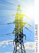 Купить «Линия электропередач на фоне солнца», фото № 23084855, снято 1 мая 2016 г. (c) Сергей Трофименко / Фотобанк Лори