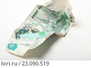 Купить «Мятая купюра 1000 рублей», эксклюзивное фото № 23090519, снято 14 июня 2016 г. (c) Яна Королёва / Фотобанк Лори