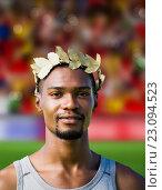 Купить «Composite image of portrait of victorious sportsman with crown of laurels», фото № 23094523, снято 20 сентября 2019 г. (c) Wavebreak Media / Фотобанк Лори