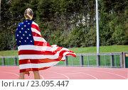 Купить «Composite image of rear view of sporty woman holding an american flag», фото № 23095447, снято 10 июля 2020 г. (c) Wavebreak Media / Фотобанк Лори