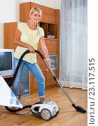 Купить «Housewife vacuuming at home», фото № 23117515, снято 17 августа 2018 г. (c) Яков Филимонов / Фотобанк Лори