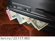 Купить «Купюры евро и доллары прижаты крышкой чемодана», эксклюзивное фото № 23117983, снято 18 июня 2016 г. (c) Юрий Морозов / Фотобанк Лори