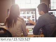 Купить «Graphic designers working at desk in the office», фото № 23123527, снято 10 апреля 2016 г. (c) Wavebreak Media / Фотобанк Лори