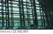 Купить «Young woman in Astana Airport», видеоролик № 23182851, снято 11 мая 2016 г. (c) Игорь Жоров / Фотобанк Лори